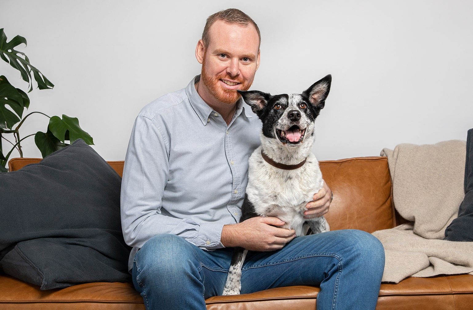 Dr Matthew Muir and Lyka on the sofa